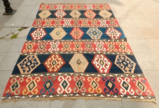 Caucasian Kilim, Late 19th Century.  Large hooked medallions. Colors are all natural dyes and contains some soft muted colors.  Great fine weave. 185 x 296 cm