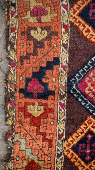 Adiyaman Kurish Long Rug, 4th quarter of the 19th century. Rich purple ground with hooked medallions with directional hooked motifs resembling an archaic tree of life in the center of each.   ...