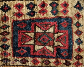 Shahsavan Kurdish group small pile saddle bag, 3rd to 4th quarter of the 19th century.  Nicely spaced white border dotted with small diamonds.  Centrally placed single 8-pointed star.  The  ...