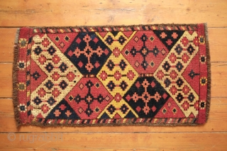 Uzbek Ikat patterned pile face, Late 19th century.  Good, strong natural colors and attractive ikat design.  Touches of petrol-like green all along the border.  Well done repairs on each  ...