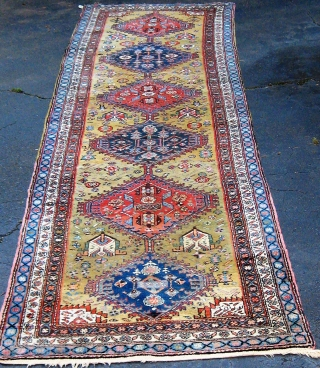 "Very folksy Kurdish runner from Western Persia, mid-20th century, in excellent condition.  Beautiful wool, full pile, signed and/or dated (see the last two photos, with human and animal figures.  42""  ..."