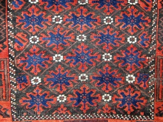 """Antique Baluch, circa 1900.  Complete, with unusual extra pile banding on both ends.  Good overall condition with oxidized brown.  Edges and sides original.  33"""" by 59""""."""