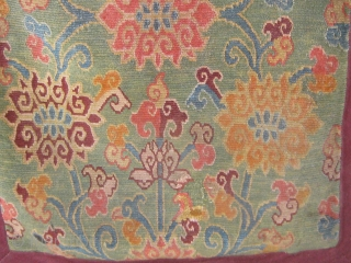 """Antique Tibetan sitting rug, circa 1880-1900.  Rare green ground, original red edging and blue cotton backing.  In very good condition with one small repair.  34"""" by 23"""".  Natural  ..."""
