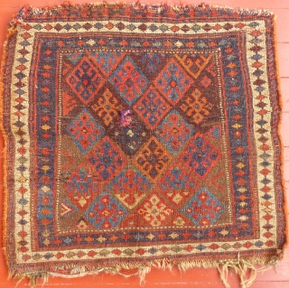 """Kurdish saddle bagface. It has one small poor repair but is in good condition otherwise.. The repair is to a small puncture hole . It measures 23"""" X 25"""", SOLD"""
