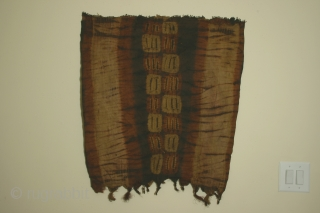 Africa: woman's tubular garment of resist dyed rafia fiber, each side 29 x 33 inches (74 x 84cm), Dida tribe, Ivory Coast, circa 1900, with some wear and losses.