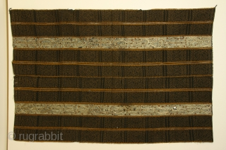 Woman's ceremonial wrapper ( tapis), Lampung region, S. Sumatra, Indonesia, cotton with resist dyed patterning ( ikat) and silk embroidery, 19th century or earlier; the center horizontal line, where the two halves  ...