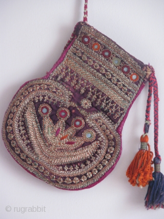 This is an old coin bag with metallic thread work on cotton,fine job and rear shape all hand stitched