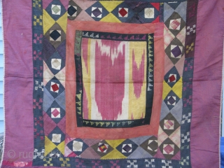 This is an old koraq(patch work)with a silk ikat in the middle part, uzbek tribe from northern Afghanistan,was used as a mirror cover(aenah posh)in the old days,