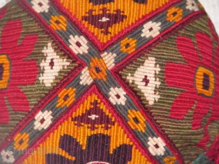 This is a hand stitched turkmen silk on cotton hat from northern Afghanistan fine work in neat clean shape,ready to be used.