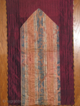 This is a child's prayer cloth made out of old Russian silk textile with interesting unusual design in the middle, bordered with old metallic maroon qassab(turkmen loom made plain textile),on the back  ...