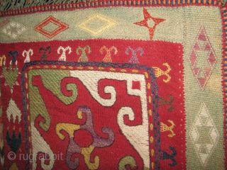 Interesting laqi suzani wool on wool square piece not turn of century old but nice enough to decorate a corner with it.