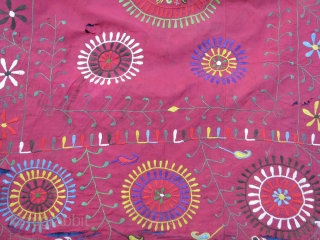 This is a tajik embroidery very old piece because it has double sides. It doesn't have any backing silk on silk
