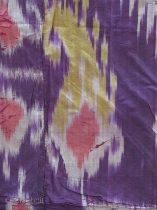 This is a very old ikat with a nice red cotton and green silk border backing superb colors front and back