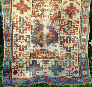 Fragmented Caucasian Moghan Rug, Memling Guls. Wool pile and warp, cotton wefts. 19th Century.  Size: 190cm x 102cm 6ft 3in x 3ft 4in. Just washed, no staining, uneven wear with full pile in  ...