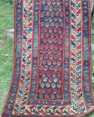 Caucasian Genje Boteh Long Rug, 19th Century. Original sides and ends, full pile, no restoration or repair. Great palette of vegetal colours, eveidence of fuchsine. Size: 8ft 1in x 3ft 7in 246cm  ...