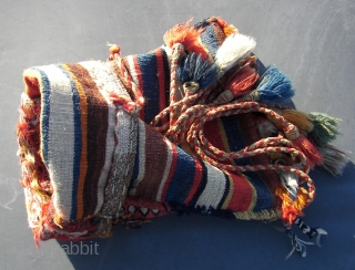 South Persian Tribal,Qashqai ? . Chanteh/Bag/ 'qalyandan,  Wool on wool and some cotton .Sumak and Kilim technique. First quarter 20Th.Cnt. 42 x 29 cm. Including tassels,and topstrap + ring 106 cm.  ...