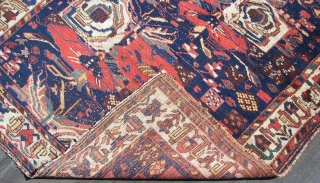 Afshar, ca. 225 cm x 155 cm. Wool on cotton, old, c-condition, some low pile,and other defects, with floral motives. Enjoy. !