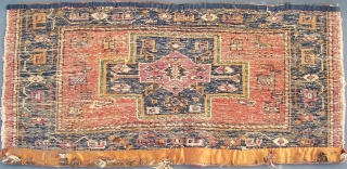 N.W. Persian bag-panel. With animals. Damaged, and faded colors.  110 cm. x 51 cm. Wool on wool with cotton wefts. Thick and rugged. Around 1930. According to its faded synthetic purple.  ...