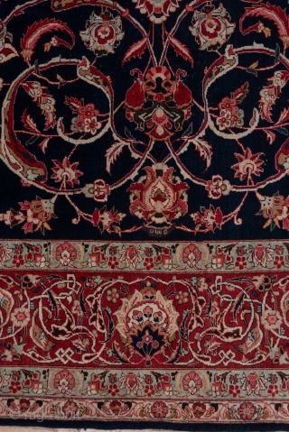 Kashan Carpet  9.0 x 11.7 2.74 x 3.56  The almost blue-black field displays an ivory medallion around which swirl layers of forked rinceaux with a variety of regular and iris palmettes and various floral   ...