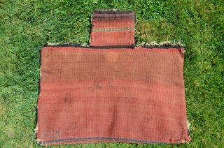"Afshar (Jabel Barez) flatwoven salt bag. 24"" X 24"". Weft substitution motifs in face. Partly decorated plain woven back. Good condition. Most of original selvage remains. Natural colors. Wool foundation."