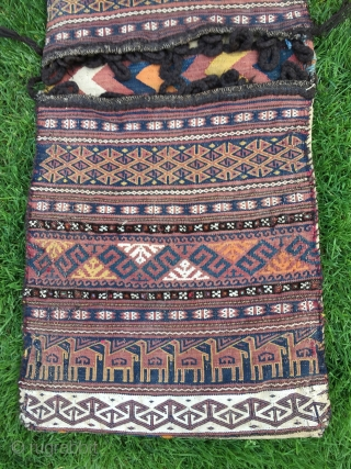 "Baluch flat woven khorjin with camel train decoration. 48-1/2"" X 19"". First 1/3 20th C. Wool. Weft substitution weave in face. Plainwoven white back. Decorated bridge. Intact closure loops. Excellent condition."