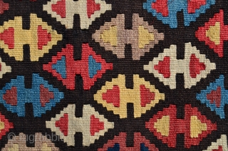 """Shahsavan flat woven (kilim) khorjin with decorated bridge.  1'10"""" X 4'1"""". Circa 1900. Wool. Some faded fuchsin in a few motifs testifies to age. Otherwise all saturated natural dyes.  Excellent  ..."""