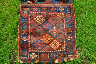 "Antique Jaff Kurd pile khorjin. 48"" X 20"". 19th C. Saturated natural dyes. Good pile on faces. Brocaded/decorated back. Good condition with some tribal use in the closure slits. Authentic tribal work  ..."