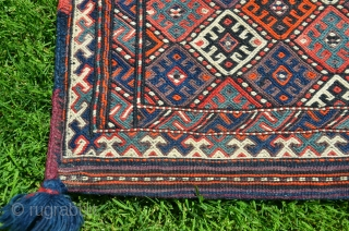 """Kordi flatwoven khorjin. 44"""" X 19"""". First 1/2 20th C. Wool. Finely woven with pleasing color palette. Brocaded diamond pattern on face. Finely striped back; intervening stripes with brocaded decorative designs. .  ..."""