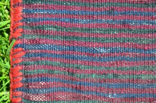 "Kordi flatwoven khorjin. 44"" X 19"". First 1/2 20th C. Wool. Finely woven with pleasing color palette. Brocaded diamond pattern on face. Finely striped back; intervening stripes with brocaded decorative designs. .  ..."