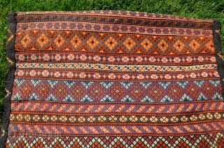 """Spectacular Qashqai flat woven khorjin.  50"""" X 25"""".  First 1/2 20thC. Wool. Bright stable colors. Rich and complex geometric designs in brocaded and weft substitution weave. Decorated goat hair border  ..."""