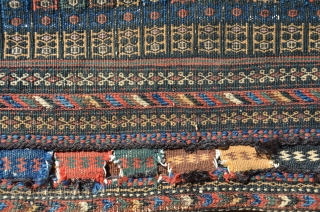 "Antique Afshar flat woven khorjin. 53"" X 26"". Circa 1900. Unusual design and palette, with brocaded or extra-weft wrapped face designs and plain woven back. Natural colors and a touch of fuchsin  ..."
