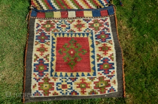 """Large flatwoven complete khorjin, NW Iran, 56 """" X 25 """", 20th C. Dovetailed tapestry. Bright color palette. Natural wool plain woven back. Kept safe in perfect unworn condition. Very reasonably priced.  ..."""