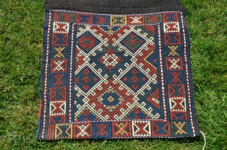 "Antique  Azeri brocaded khorjin. 48"" X 20"" Late 19th C.Faces with brocaded geometric designs. Warm natural colors. Plainnwoven black back- black backs usually signify an early date.  Except for a  ..."