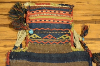 "Antique Kordi salt bag, NE Iran. 22-1/2"" X 13-1/2"". Circa 1900. All wool. Brocaded face and decorated plain woven back in undyed natural wool.  Original carrying cord, tassels and edge wrappings.  ..."
