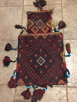 """Antique Kordi salt bag, NE Iran. 22-1/2"""" X 13-1/2"""". Circa 1900. All wool. Brocaded face and decorated plain woven back in undyed natural wool.  Original carrying cord, tassels and edge wrappings.  ..."""