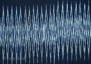 Sumatra | Batak Ikat Shoulder-cloth (Bintang Maratur)  Indonesia, Sumatra, Toba Batak, Silindung Valley; mid 20th C  Commercial cotton, natural and commercial dyes, warp ikat, supplementary warp and weft weaving, twining  A single panel with an  ...