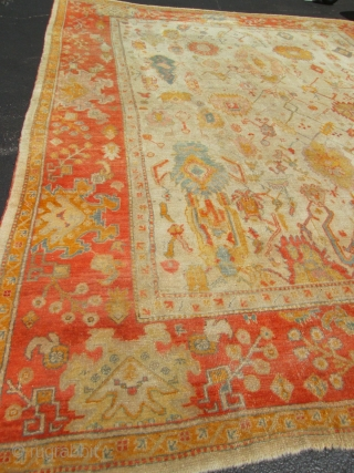 Awesome Antique Turkish Oushak Rug.  size 12'x14'.condition very good low even pile . miner old repile see photo.circa 1880. gooe colors and design.