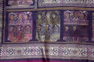 Pallav of a Baluchar Sari woven in silk Brocade From Murshidabad,West Bengal,India.The motifs of butta cones and Figures of Europeans travelling in railway carriages.British administrators were instrumental in reviving the industry there  ...