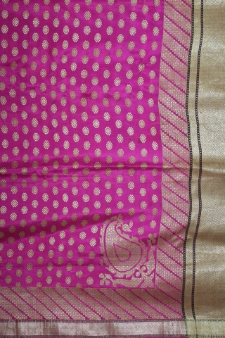 Odhni Zari Brocade(Real Silver and Gold) from Jamnagar Gujarat India.The pattern is made up of kairi,paisley, placed as a konia at the corners of the pallu.The broad plain chaudani pallu is outlined  ...