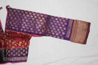 Child's(choli) from Bansali Community,kutch,Gujarat India early 20th century. Left side panel used Ambar Brocade. Right side panel used Aba Silk Fabric.(DSC01530).