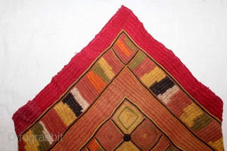 Banjara Dowry(Envelope) Bag From Karnataka,South India.C.1900.Embroidered on cotton.This is a square embroidery that has been folded and sewn to form the bag.This piece is executed in several types of stitches including, chain,  ...