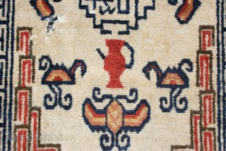Strikingly graphic Ningsia (?) mat with quirky design features. Sadly, the moths have had a fine old time. 39in by 23in