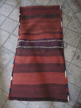 SW persia saddle bag in fine condition.a small places were sweeinged by villagers.not washed.great colores and texture.Size:153x 72 cm