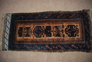 Old Baluch balisht with a design of two large flowers and two large blossoms, 46 x 103 cm, rather good condition