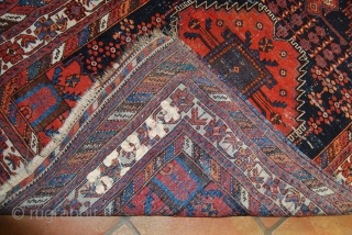 Old Afshar rug with two vases, 114 x 147 cm, traces of use and wear