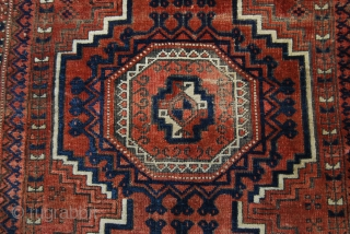 Old Baluch rug with four large Salor guls, traces of wear and oxidation but complete, 103 x 198 cm