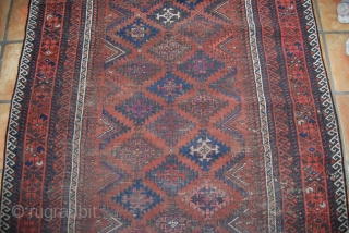 Antique Baluch carpet, 19th c., 120 x 185 (with kilim ends), some knots with fuchsin, condition issues, thin, several small holes