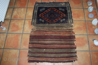 Antique Baluch bag (opened), 110 x 70 cm, traces of use and wear, small damages at the corners of the knotted part and a hole at top right, there is fuchsin as  ...