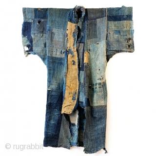 Boro Yogi - Meiji Era Indigo Yogi  An antique heavily worn, repaired and weathered, museum quality boro yogi.  This piece balances a blend of what most collectors seek in boro - a visual aesthetic  ...