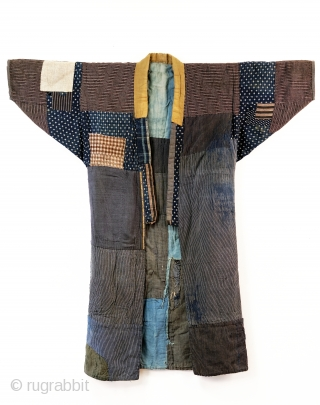 Heavily patched boro noragi displays years of use. 